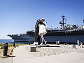 USA, San Diego, view to sculpture 'Unconditional Surrender' in front of USS Midway Museum - SBD002319