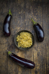 Bowl of Baba Ghanoush and aubergines on wood - LVF003991