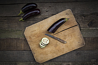 Aubergines on chopping board, knife - LVF003997