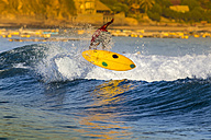 Indonesia, Lombok, surfing man - KNTF000111