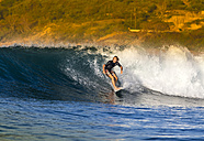 Indonesia, Lombok, surfing man - KNTF000114