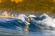 Indonesia, Lombok, surfing man - KNTF000117
