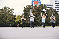 Four women having an outdoor boot camp workout - MADF000527