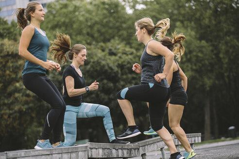 Four women having an outdoor workout - MADF000557