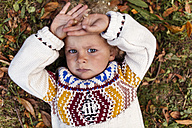 Portrait of pouting blond little boy wearing patterned knit pullover - MGOF000873