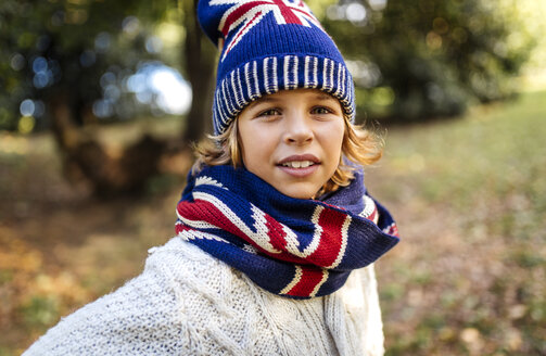 Portrait of blond boy wearing fashionable knit wear in autumn - MGOF000876
