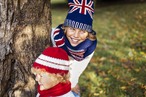Portrait of two blond boys wearing fashionable knit wear in autumn - MGOF000882