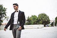 Young man wearing jacket and a wooden bow tie - RAEF000551