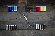 Scissors and cotton reels on wood - LVF004034