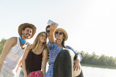 Happy friends taking a selfie at the river - UUF005852
