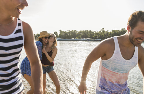 Happy friends at the river in summer - UUF005864