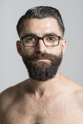 Portrait of a mid adult bare-chested man with full beard and glasses - JASF000179