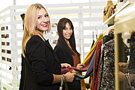 Young women in fashion boutique shopping for clothes - JASF000207