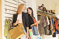 Young women in fashion boutique having fun - JASF000210