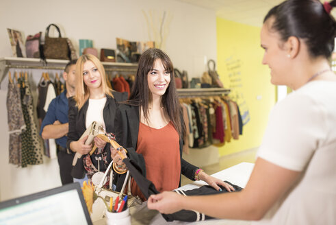 Young women in fashion boutique shopping for clothes - JASF000222