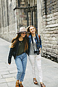 Spain, Barcelona, two young women walking in the city - EBSF000938