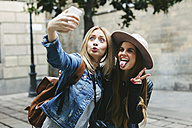 Two playful young women taking a selfie - EBSF000950