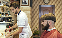 Barber and customer in a barber shop - MGOF000885