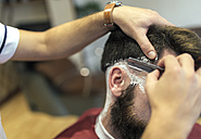 Barber shaving beard of a customer - MGOF000888
