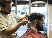 Barber shaving head of a customer - MGOF000891