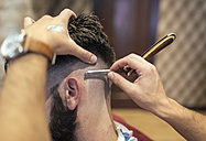 Barber shaving head of a customer - MGOF000900