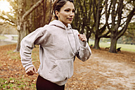 Woman jogging in park during autumn - MFF002454