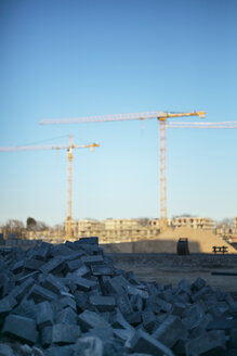 Germany, Cologne, construction area, stones, cranes in the background - DASF000002