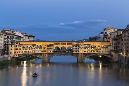 Italy, Tuscany, Florence, View of Arno River and Ponte Vecchio in the evening - FOF008347
