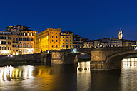 Italy, Tuscany, Florence, View of Arno River and Ponte Vecchio in the evening - FOF008350