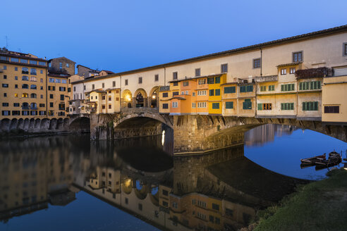 Italy, Tuscany, Florence, View of Arno River and Ponte Vecchio in the evening - FOF008353