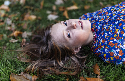 Portrait of girl lying on a meadow - MGOF000944