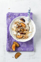 Bowl of soured milk with quinoa, plums, sunflower seed and cinnamon - MYF001179
