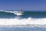 Indonesia, Bali, surfing woman - KNTF000139