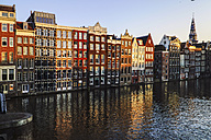 Netherlands, Amsterdam, Damrak, view to row of canal houses in the old town - HOHF001370