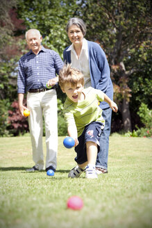 Little boy playing boccia with his grandparents - RMAF000008