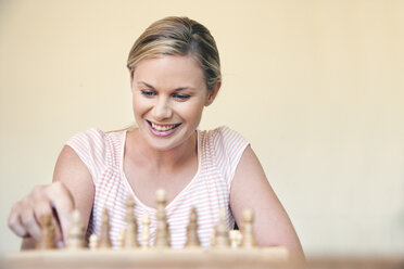 Portrait of woman playing chess - RMAF000035