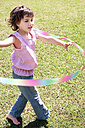 Little girl playing with hula-hoop in the garden - RMAF000059