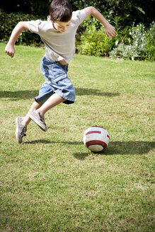 Little boy playing soccer in the garden - RMAF000071