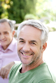 Portrait of smiling man with grey hair and stubble - RMAF000112