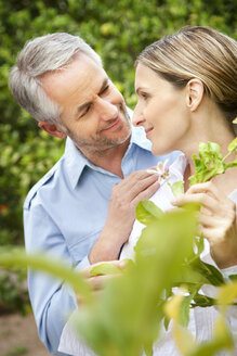 Portrait of happy couple face to face in the garden - RMAF000127