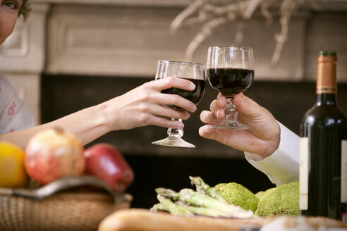 Hands of couple toasting with red wine - RMAF000139