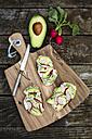Avocado radish bread on chopping board - SARF002246