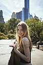 USA, New York City, portrait of young woman in Central Park - GIOF000340