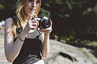 Young woman outdoors with camera - GIOF000346