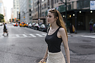USA, New York City, young woman on the go in Manhattan - GIOF000352