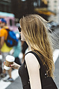 USA, New York City, young woman on the go in Manhattan - GIOF000355