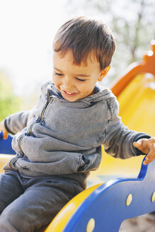 Happy boy on a slide at the playground - EBSF000989