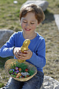 Portrait of smiling little boy with Easter nest and Easter bunny - LBF001271