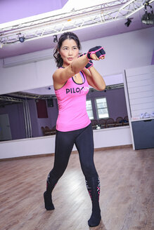Asian woman exercising piloxing - VT000457