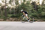 Cyclist riding a bike on a road - JRFF000168
